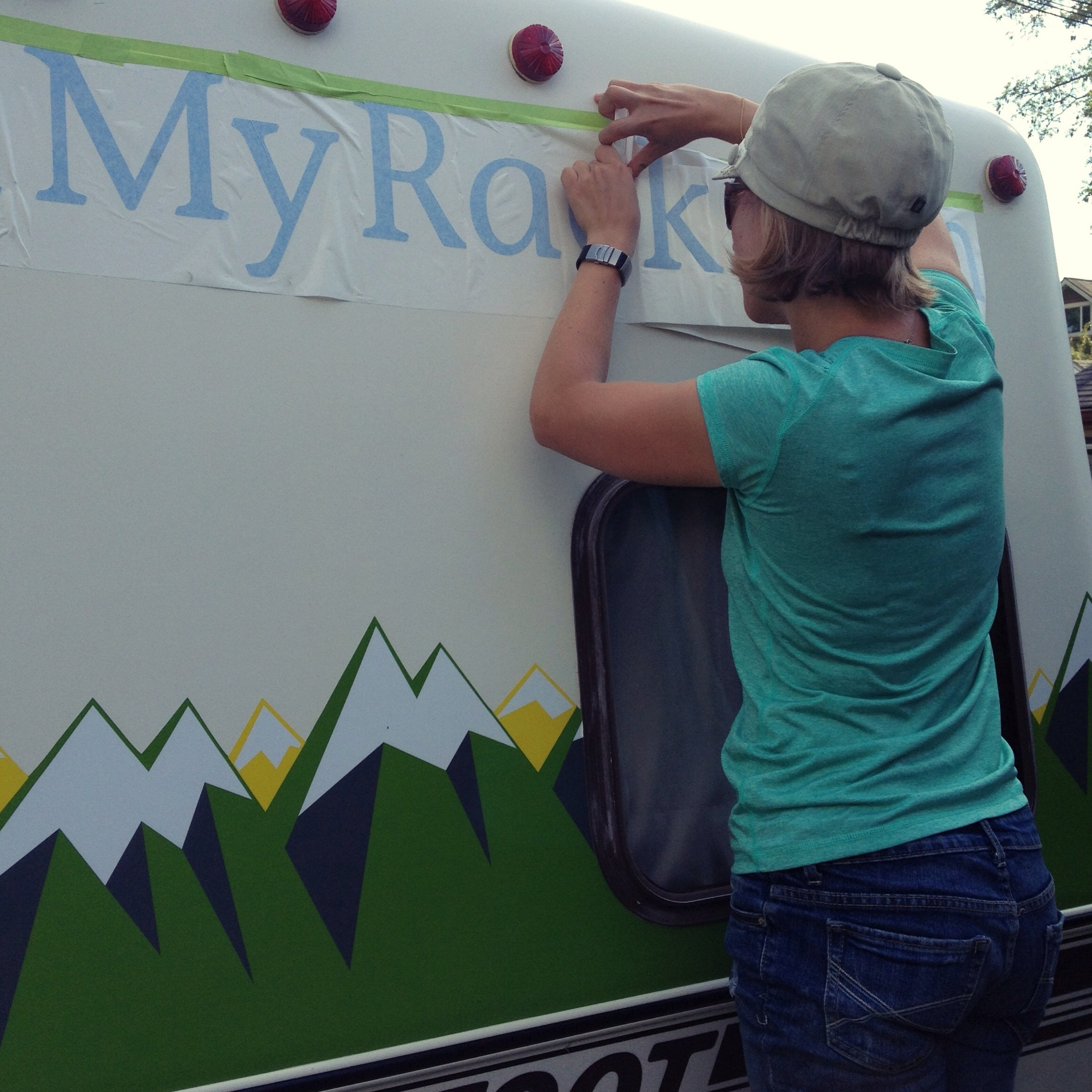 Alison putting on WeighMyRack decals