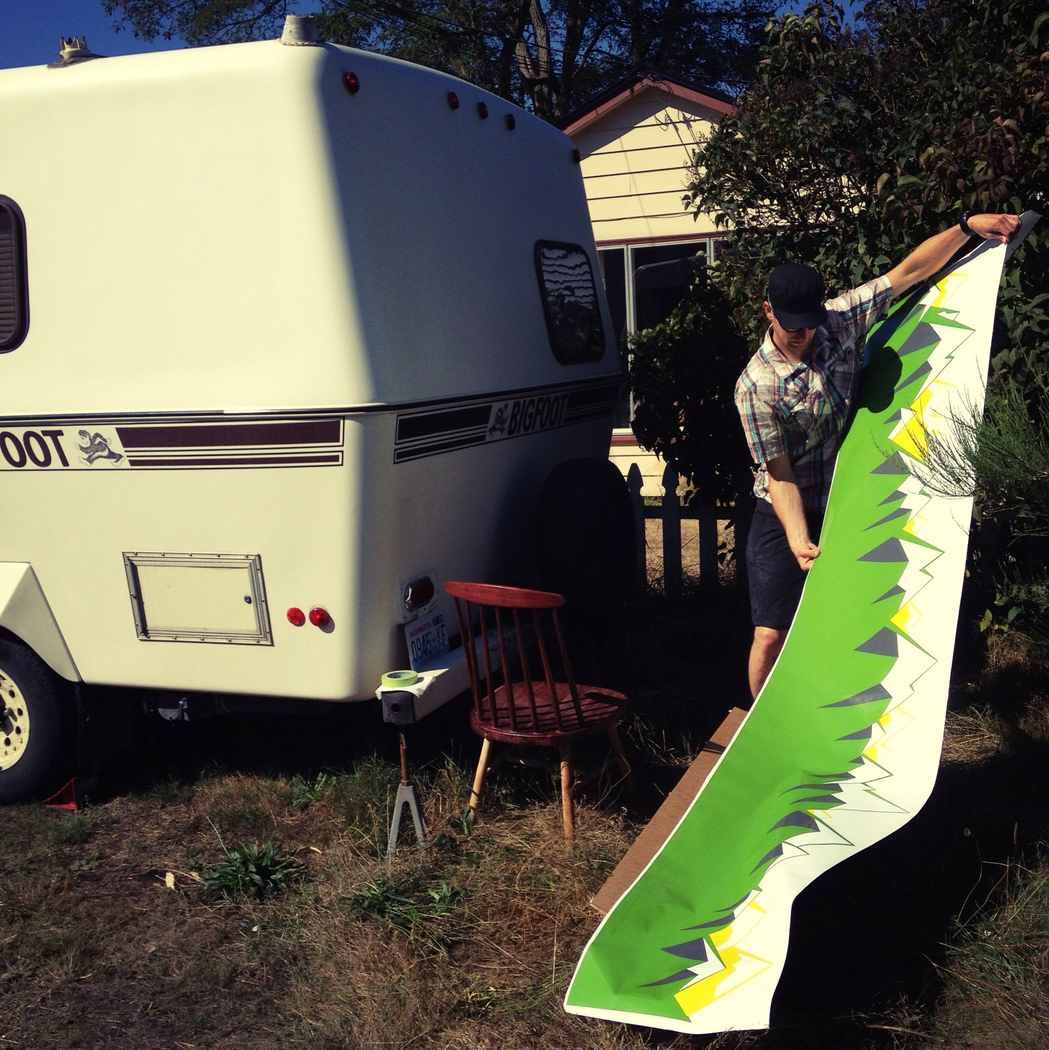 Andreas putting on the WeighMyRack Camper Wrap