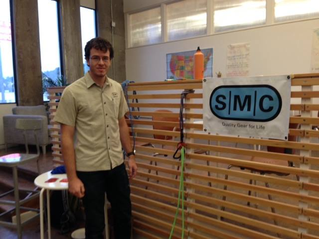 Max from SMC showing off the Spire Belay Device