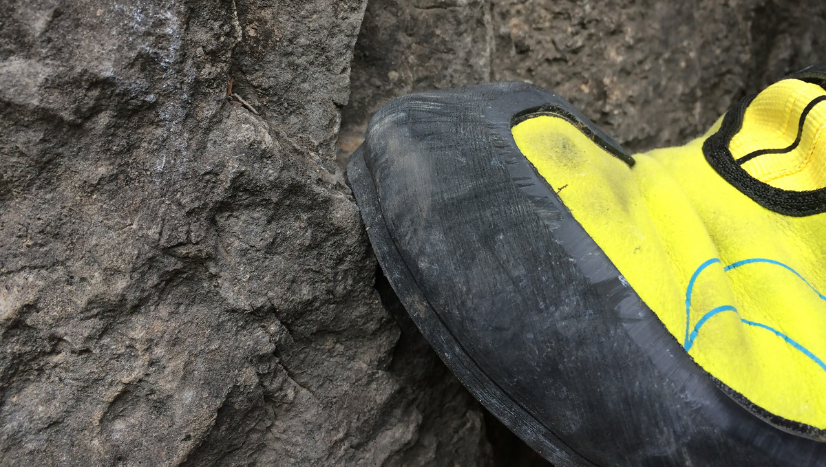 Too small! The rand rubber bulging beyond the edge of the sole.