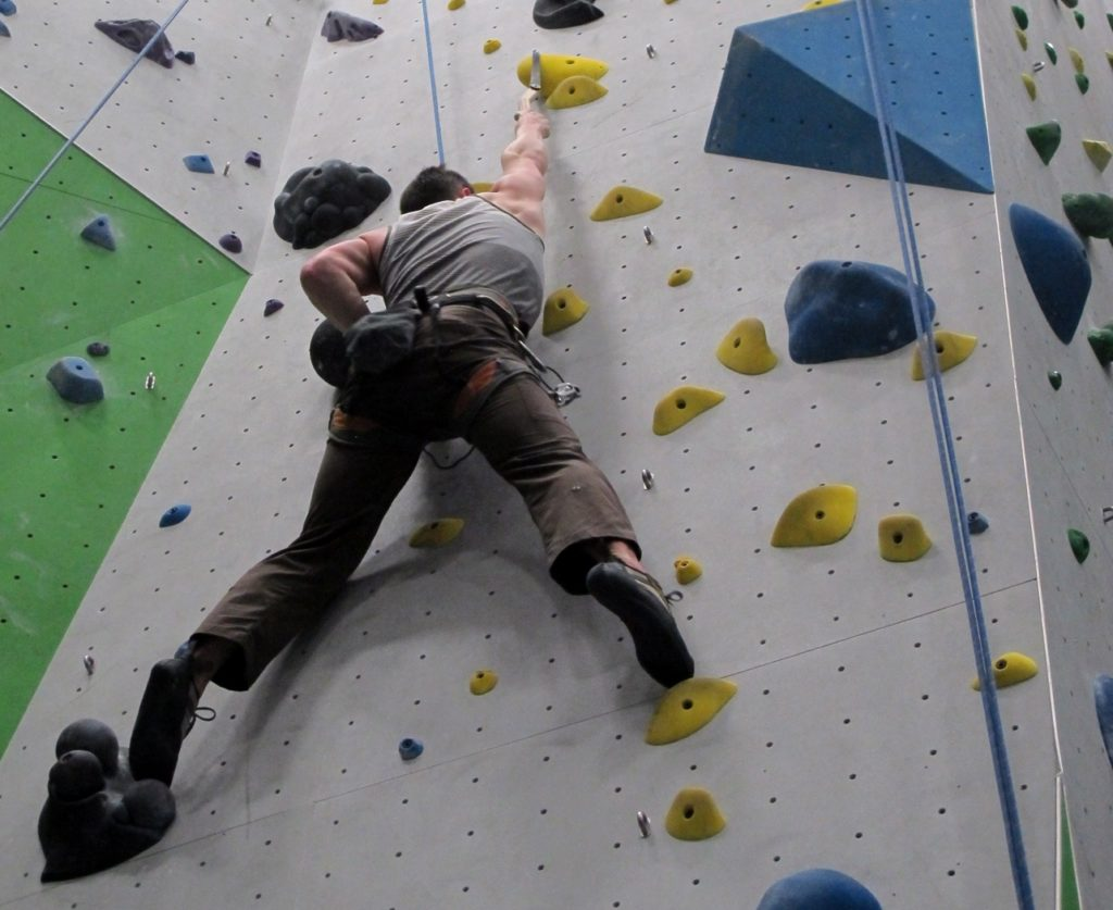 Climbing Gym stretching to hold with dry ice tools